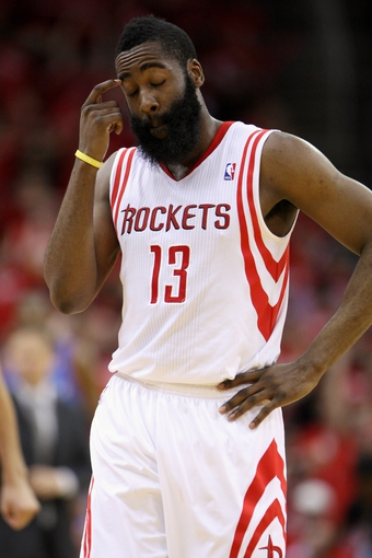 May 3, 2013; Houston, TX, USA; Houston Rockets shooting guard James Harden (13) reacts after a play during the fourth quarter in game six of the first round of the 2013 NBA Playoffs against the Oklahoma City Thunder at the Toyota Center. Mandatory Credit: Troy Taormina-USA TODAY Sports
