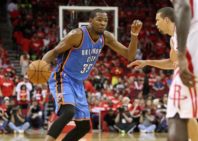 May 3, 2013; Houston, TX, USA; Oklahoma City Thunder small forward Kevin Durant (35) controls the ball during the fourth quarter against the Houston Rockets in game six of the first round of the 2013 NBA Playoffs at the Toyota Center. Mandatory Credit: Troy Taormina-USA TODAY Sports