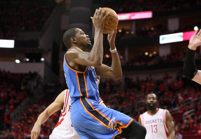May 3, 2013; Houston, TX, USA; Oklahoma City Thunder small forward Kevin Durant (35) drives the ball to the basket during the fourth quarter against the Houston Rockets in game six of the first round of the 2013 NBA Playoffs at the Toyota Center. Mandatory Credit: Troy Taormina-USA TODAY Sports