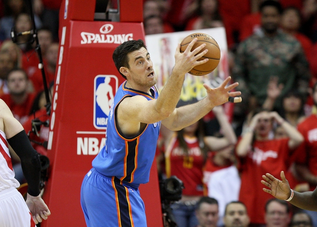 May 3, 2013; Houston, TX, USA; Oklahoma City Thunder power forward Nick Collison (4) gets a rebound during the fourth quarter against the Houston Rockets in game six of the first round of the 2013 NBA Playoffs at the Toyota Center. Mandatory Credit: Troy Taormina-USA TODAY Sports