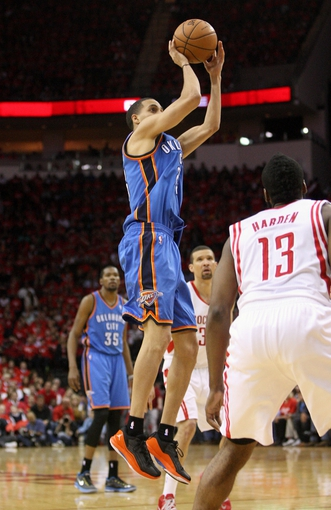 May 3, 2013; Houston, TX, USA; Oklahoma City Thunder shooting guard Kevin Martin (23) attempts a jump shot during the third quarter against the Houston Rockets in game six of the first round of the 2013 NBA Playoffs at the Toyota Center. Mandatory Credit: Troy Taormina-USA TODAY Sports