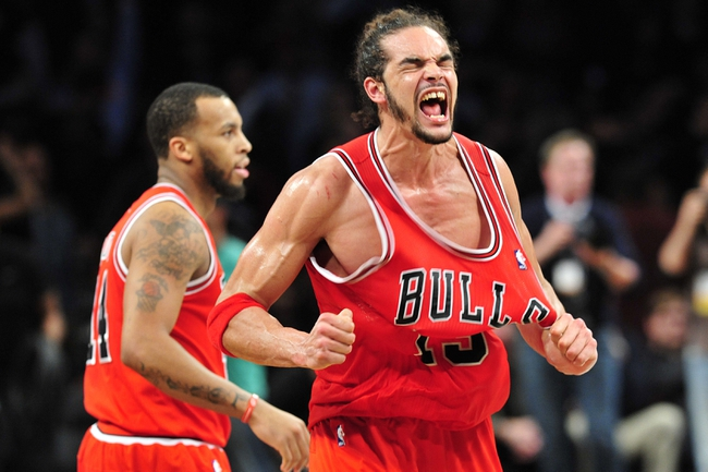 May 4, 2013; Brooklyn, NY, USA; Chicago Bulls center Joakim Noah (13) celebrates after his team's win during the second half in game seven of the first round of the 2013 NBA Playoffs at the Barclays Center. The Bulls won 99-93Mandatory Credit: Joe Camporeale-USA TODAY Sports