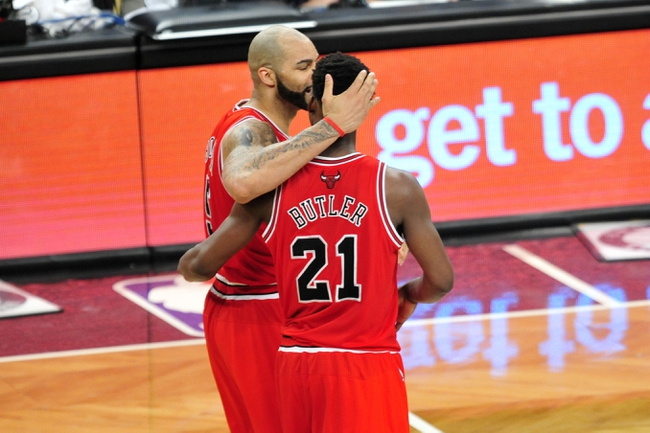 May 4, 2013; Brooklyn, NY, USA; Chicago Bulls power forward Carlos Boozer (5) and Chicago Bulls small forward Jimmy Butler (21) celebrate against the Brooklyn Nets during the second half in game seven of the first round of the 2013 NBA Playoffs at the Barclays Center. The Bulls won 99-93. Mandatory Credit: Joe Camporeale-USA TODAY Sports