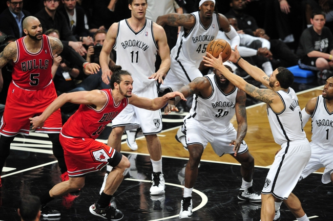 May 4, 2013; Brooklyn, NY, USA; Chicago Bulls shooting guard Marco Belinelli (8) grabs a rebound against the Chicago Bulls during the second half in game seven of the first round of the 2013 NBA Playoffs at the Barclays Center. The Bulls won 99-93. Mandatory Credit: Joe Camporeale-USA TODAY Sports