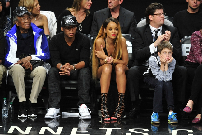 May 4, 2013; Brooklyn, NY, USA; Music recording artist Rihanna (center) looks on at the Chicago Bulls and Brooklyn Nets game during the second half in game seven of the first round of the 2013 NBA Playoffs at the Barclays Center. The Bulls won 99-93. Mandatory Credit: Joe Camporeale-USA TODAY Sports