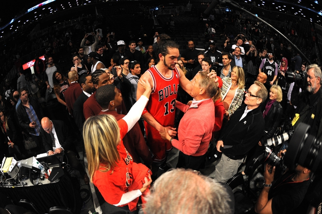 May 4, 2013; Brooklyn, NY, USA; Chicago Bulls center Joakim Noah (13) celebrates with his family after the second half in game seven of the first round of the 2013 NBA Playoffs at the Barclays Center. The Bulls won 99-93. Mandatory Credit: Joe Camporeale-USA TODAY Sports