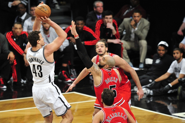 May 4, 2013; Brooklyn, NY, USA; Brooklyn Nets power forward Kris Humphries (43) puts up a shot over Chicago Bulls power forward Carlos Boozer (5) during the second half in game seven of the first round of the 2013 NBA Playoffs at the Barclays Center. The Bulls won 99-93. Mandatory Credit: Joe Camporeale-USA TODAY Sports