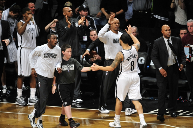 May 4, 2013; Brooklyn, NY, USA; Brooklyn Nets point guard Deron Williams (8) celebrates with the Nets bench during the second half in game seven of the first round of the 2013 NBA Playoffs against the Chicago Bulls at the Barclays Center. The Bulls won 99-93. Mandatory Credit: Joe Camporeale-USA TODAY Sports