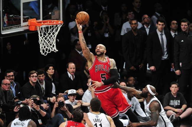 May 4, 2013; Brooklyn, NY, USA; Chicago Bulls power forward Carlos Boozer (5) puts up a layup against the Brooklyn Nets during the second half in game seven of the first round of the 2013 NBA Playoffs at the Barclays Center. The Bulls won 99-93. Mandatory Credit: Joe Camporeale-USA TODAY Sports