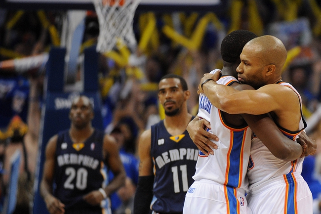 May 5, 2013; Oklahoma City, OK, USA; Oklahoma City Thunder guard Reggie Jackson (15) hugs Thunder guard Derek Fisher (6) after defeating the Memphis Grizzlies in game one of the second round of the 2013 NBA Playoffs at Chesapeake Energy Arena. The Thunder defeated the Grizzlies 93-91. Mandatory Credit: Mark D. Smith-USA TODAY Sports