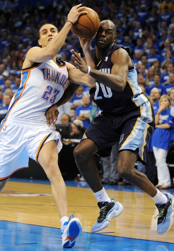 May 5, 2013; Oklahoma City, OK, USA; Oklahoma City Thunder guard Kevin Martin (23) handles the ball against Memphis Grizzlies forward Quincy Pondexter (20) during the second half in game one of the second round of the 2013 NBA Playoffs at Chesapeake Energy Arena. The Thunder defeated the Grizzlies 93-91. Mandatory Credit: Mark D. Smith-USA TODAY Sports