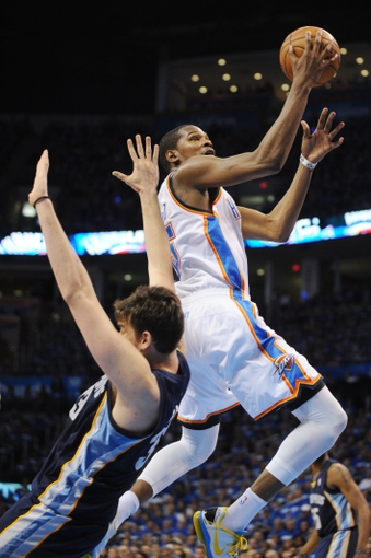 May 5, 2013; Oklahoma City, OK, USA; Oklahoma City Thunder forward Kevin Durant (top) attempts a shot against Memphis Grizzlies center Marc Gasol (33) during the second half in game one of the second round of the 2013 NBA Playoffs at Chesapeake Energy Arena. The Thunder defeated the Grizzlies 93-91. Mandatory Credit: Mark D. Smith-USA TODAY Sports