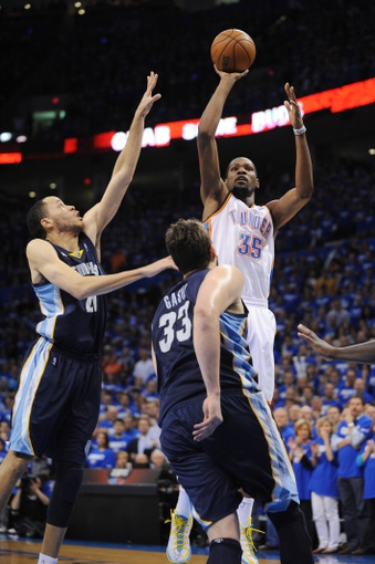 May 5, 2013; Oklahoma City, OK, USA; Oklahoma City Thunder forward Kevin Durant (35) attempts a shot against Memphis Grizzlies center Marc Gasol (33) and Grizzlies forward Tayshaun Prince (21) during the second half in game one of the second round of the 2013 NBA Playoffs at Chesapeake Energy Arena. The Thunder defeated the Grizzlies 93-91. Mandatory Credit: Mark D. Smith-USA TODAY Sports