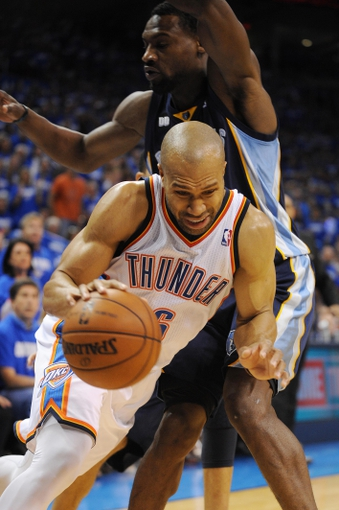 May 5, 2013; Oklahoma City, OK, USA; Oklahoma City Thunder guard Derek Fisher (6) handles the ball against Memphis Grizzlies guard Tony Allen (9) during the second half in game one of the second round of the 2013 NBA Playoffs at Chesapeake Energy Arena. The Thunder defeated the Grizzlies 93-91. Mandatory Credit: Mark D. Smith-USA TODAY Sports