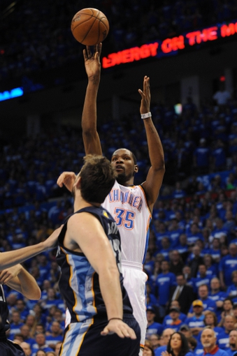 May 5, 2013; Oklahoma City, OK, USA; Oklahoma City Thunder forward Kevin Durant (35) attempts a shot against Memphis Grizzlies center Marc Gasol (33) during the second half in game one of the second round of the 2013 NBA Playoffs at Chesapeake Energy Arena. The Thunder defeated the Grizzlies 93-91. Mandatory Credit: Mark D. Smith-USA TODAY Sports