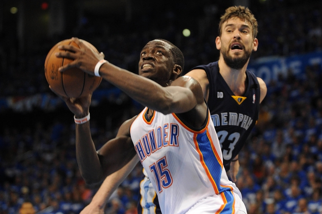 May 5, 2013; Oklahoma City, OK, USA; Oklahoma City Thunder guard Reggie Jackson (15) attempts a shot against Memphis Grizzlies center Marc Gasol (33) during the second half in game one of the second round of the 2013 NBA Playoffs at Chesapeake Energy Arena. The Thunder defeated the Grizzlies 93-91. Mandatory Credit: Mark D. Smith-USA TODAY Sports