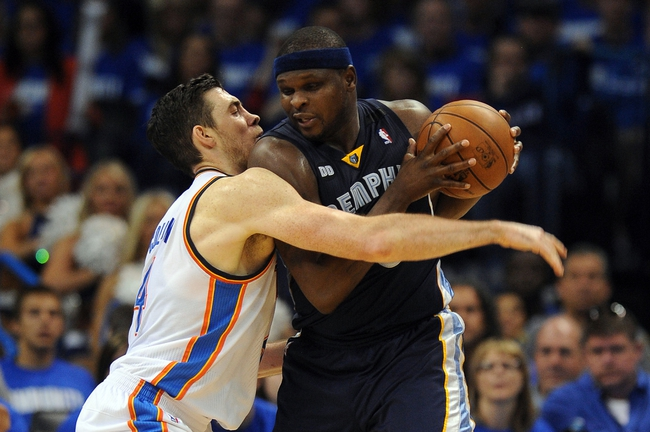 May 5, 2013; Oklahoma City, OK, USA; Memphis Grizzlies forward Zach Randolph (50) handles the ball against Oklahoma City Thunder forward Nick Collison (4) during the second half in game one of the second round of the 2013 NBA Playoffs at Chesapeake Energy Arena. The Thunder defeated the Grizzlies 93-91. Mandatory Credit: Mark D. Smith-USA TODAY Sports