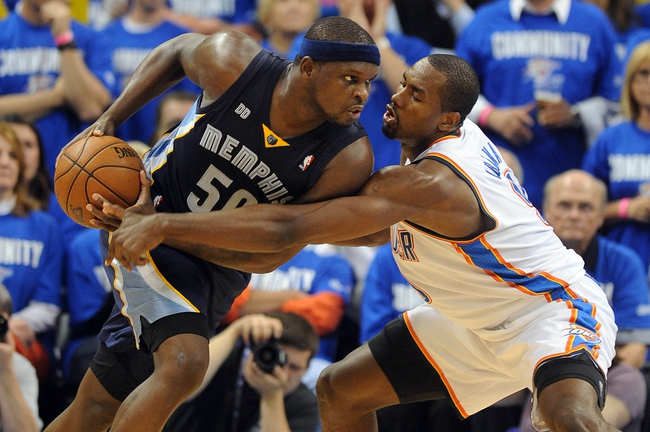 May 5, 2013; Oklahoma City, OK, USA; Memphis Grizzlies forward Zach Randolph (50) handles the ball against Oklahoma City Thunder forward Serge Ibaka (9) during the second half in game one of the second round of the 2013 NBA Playoffs at Chesapeake Energy Arena. The Thunder defeated the Grizzlies 93-91. Mandatory Credit: Mark D. Smith-USA TODAY Sports