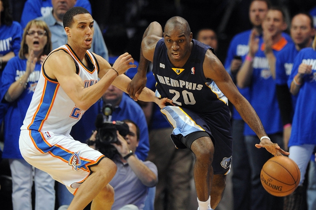 May 5, 2013; Oklahoma City, OK, USA; Memphis Grizzlies forward Quincy Pondexter (20) handles the ball against Oklahoma City Thunder guard Kevin Martin (23) during the second half in game one of the second round of the 2013 NBA Playoffs at Chesapeake Energy Arena. The Thunder defeated the Grizzlies 93-91. Mandatory Credit: Mark D. Smith-USA TODAY Sports