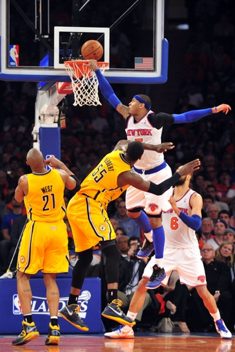 May 5, 2013; New York, NY, USA; New York Knicks small forward Carmelo Anthony (7) attempts a dunk over Indiana Pacers center Roy Hibbert (55) during the second half of game one of the second round of the NBA Playoffs. Pacers won the game 102-95. Mandatory Credit: Joe Camporeale-USA TODAY Sports
