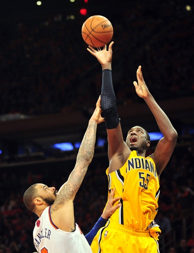 May 5, 2013; New York, NY, USA; Indiana Pacers center Roy Hibbert (55) puts up a shot over New York Knicks center Tyson Chandler (6) during the second half of game one of the second round of the NBA Playoffs. Pacers won the game 102-95. Mandatory Credit: Joe Camporeale-USA TODAY Sports