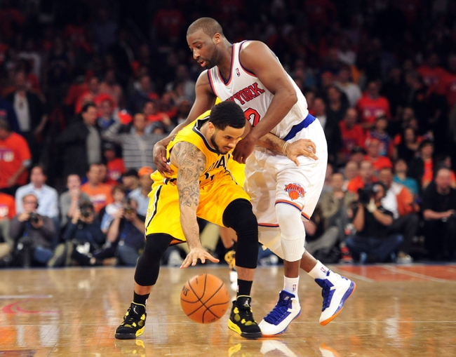 May 5, 2013; New York, NY, USA; New York Knicks point guard Raymond Felton (2) fouls Indiana Pacers point guard George Hill (3) during the second half of game one of the second round of the NBA Playoffs. Pacers won the game 102-95. Mandatory Credit: Joe Camporeale-USA TODAY Sports