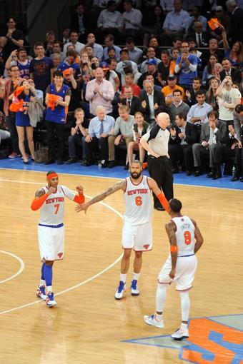 May 7, 2013; New York, NY, USA; New York Knicks fans, center Tyson Chandler (6), and shooting guard J.R. Smith (8) celebrate a basket by small forward Carmelo Anthony (7) against the Indiana Pacers during the second half in game two of the second round of the 2013 NBA Playoffs at Madison Square Garden. Knicks won the game 105-79. Mandatory Credit: Joe Camporeale-USA TODAY Sports