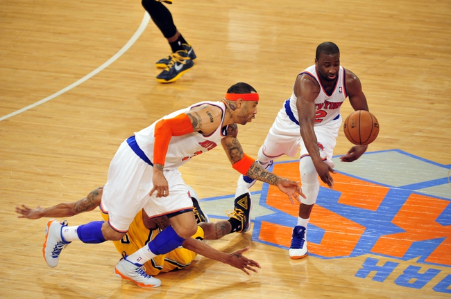 May 7, 2013; New York, NY, USA; New York Knicks power forward Kenyon Martin (3) and point guard Raymond Felton (2) knock the ball away from Indiana Pacers point guard George Hill (3) during the second half in game two of the second round of the 2013 NBA Playoffs at Madison Square Garden. Knicks won the game 105-79. Mandatory Credit: Joe Camporeale-USA TODAY Sports