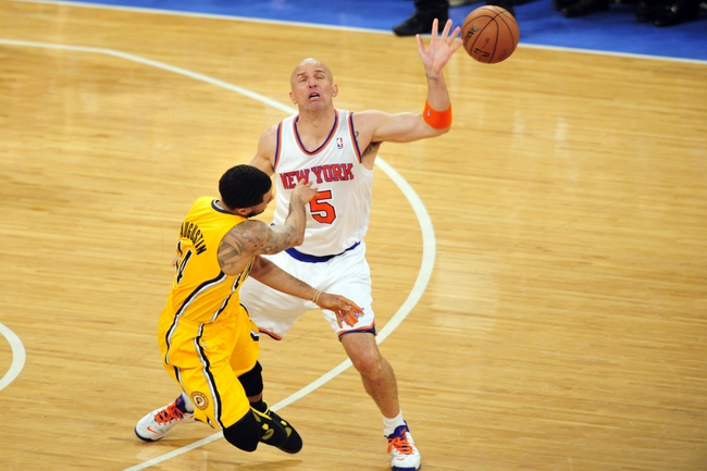 May 7, 2013; New York, NY, USA; Indiana Pacers point guard D.J. Augustin (14) makes a pass by New York Knicks point guard Jason Kidd (5) during the second half in game two of the second round of the 2013 NBA Playoffs at Madison Square Garden. Knicks won the game 105-79. Mandatory Credit: Joe Camporeale-USA TODAY Sports