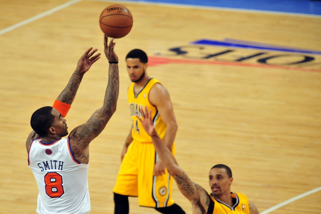 May 7, 2013; New York, NY, USA; New York Knicks shooting guard J.R. Smith (8) shoots over Indiana Pacers point guard George Hill (3) during the second half in game two of the second round of the 2013 NBA Playoffs at Madison Square Garden. Knicks won the game 105-79. Mandatory Credit: Joe Camporeale-USA TODAY Sports