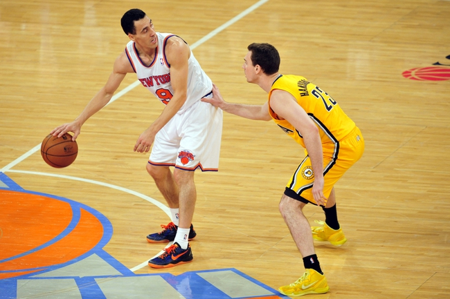 May 7, 2013; New York, NY, USA; New York Knicks point guard Pablo Prigioni (9) dribbles against Indiana Pacers point guard Ben Hansbrough (23) during the second half in game two of the second round of the 2013 NBA Playoffs at Madison Square Garden. Knicks won the game 105-79. Mandatory Credit: Joe Camporeale-USA TODAY Sports
