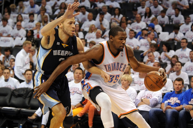 May 7, 2013; Oklahoma City, OK, USA; Oklahoma City Thunder forward Kevin Durant (35) handles the ball against Memphis Grizzlies forward Tayshaun Prince (21) during the first half in game two of the second round of the 2013 NBA Playoffs at Chesapeake Energy Arena. Mandatory Credit: Mark D. Smith-USA TODAY Sports