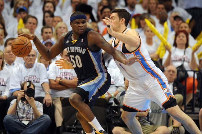 May 7, 2013; Oklahoma City, OK, USA; Memphis Grizzlies forward Zach Randolph (50) handles the ball against Oklahoma City Thunder forward Nick Collison (4) during the second half in game two of the second round of the 2013 NBA Playoffs at Chesapeake Energy Arena. Mandatory Credit: Mark D. Smith-USA TODAY Sports