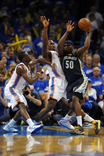 May 7, 2013; Oklahoma City, OK, USA; Memphis Grizzlies forward Zach Randolph (50) handles the ball against Oklahoma City Thunder forward Serge Ibaka (9) and Thunder guard Reggie Jackson (15) during the second half in game two of the second round of the 2013 NBA Playoffs at Chesapeake Energy Arena. Mandatory Credit: Mark D. Smith-USA TODAY Sports