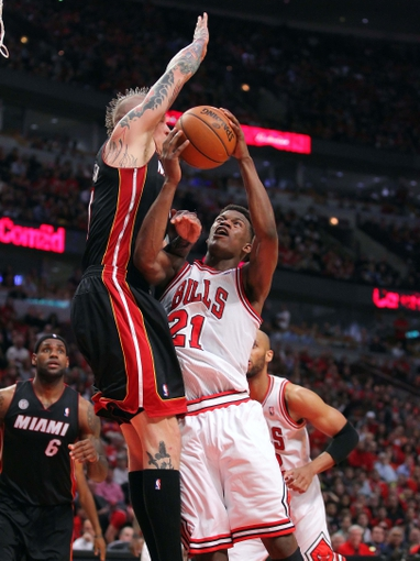 May 10, 2013; Chicago, IL, USA; Chicago Bulls small forward Jimmy Butler (21) scores over Miami Heat power forward Chris Andersen (11) during the second half in game three of the second round of the 2013 NBA Playoffs at the United Center. Miami won 104-94. Mandatory Credit: Dennis Wierzbicki-USA TODAY Sports