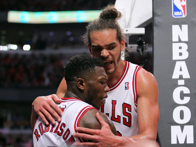 May 10, 2013; Chicago, IL, USA; Chicago Bulls point guard Nate Robinson (2) is embraced by center Joakim Noah (13) during the second half in game three of the second round of the 2013 NBA Playoffs against the Miami Heat at the United Center. Miami won 104-94. Mandatory Credit: Dennis Wierzbicki-USA TODAY Sports