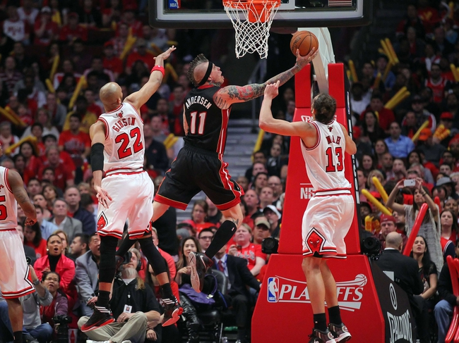 May 10, 2013; Chicago, IL, USA; Miami Heat power forward Chris Andersen (center) scores between Chicago Bulls power forward Taj Gibson (left) and Chicago Bulls center Joakim Noah (right) during the second half in game three of the second round of the 2013 NBA Playoffs at the United Center. Miami won 104-94. Mandatory Credit: Dennis Wierzbicki-USA TODAY Sports