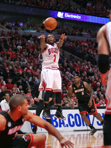 May 10, 2013; Chicago, IL, USA; Chicago Bulls point guard Nate Robinson (2) makes a pass during the second half in game three of the second round of the 2013 NBA Playoffs against the Miami Heat at the United Center. Miami won 104-94. Mandatory Credit: Dennis Wierzbicki-USA TODAY Sports