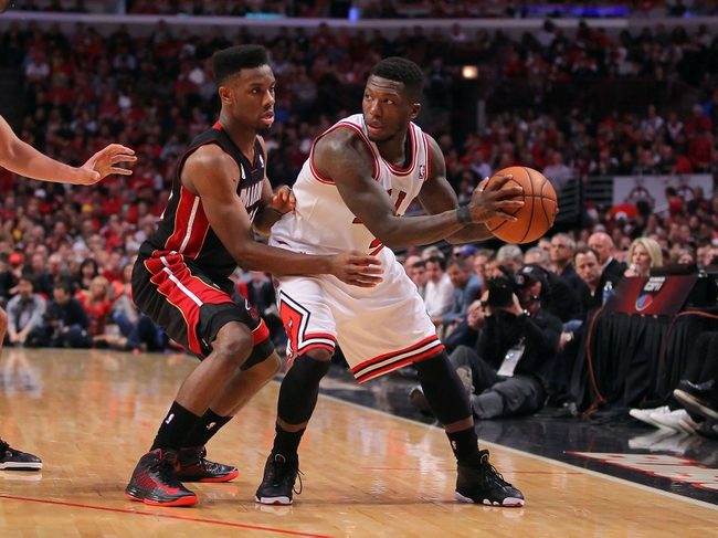 May 10, 2013; Chicago, IL, USA; Chicago Bulls point guard Nate Robinson (2) being defended by Miami Heat point guard Norris Cole (30) during the second half in game three of the second round of the 2013 NBA Playoffs at the United Center. Miami won 104-94. Mandatory Credit: Dennis Wierzbicki-USA TODAY Sports