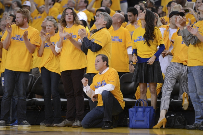 May 12, 2013; Oakland, CA, USA; Golden State Warriors owner Joe Lacob (kneeling) reacts at the end of the fourth quarter in game four of the second round of the 2013 NBA Playoffs against the San Antonio Spurs at Oracle Arena. The Warriors defeated the Spurs 97-87 in overtime. Mandatory Credit: Kyle Terada-USA TODAY Sports