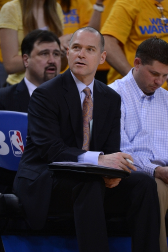 May 2, 2013; Oakland, CA, USA; Golden State Warriors assistant coach Michael Malone looks on from the bench during the fourth quarter of game six of the first round of the 2013 NBA Playoffs against the Denver Nuggets at Oracle Arena. The Warriors defeated the Nuggets 92-88. Mandatory Credit: Kyle Terada-USA TODAY Sports