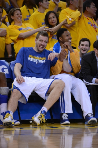 May 2, 2013; Oakland, CA, USA; Golden State Warriors power forward David Lee (10, left) and shooting guard Kent Bazemore (20, right) laugh during the fourth quarter of game six of the first round of the 2013 NBA Playoffs against the Denver Nuggets at Oracle Arena. The Warriors defeated the Nuggets 92-88. Mandatory Credit: Kyle Terada-USA TODAY Sports