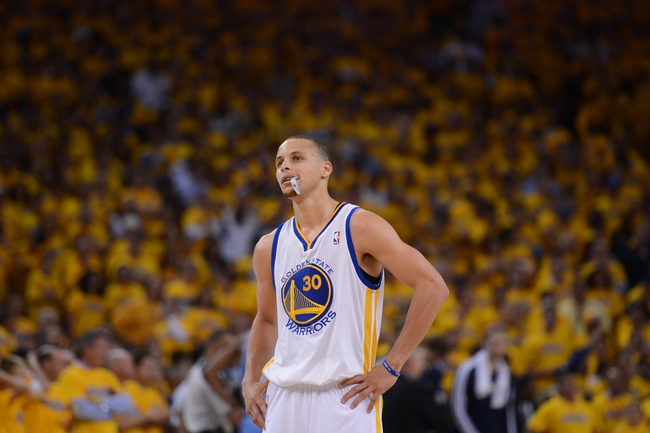 May 2, 2013; Oakland, CA, USA; Golden State Warriors point guard Stephen Curry (30) looks on against the Denver Nuggets during the fourth quarter of game six of the first round of the 2013 NBA Playoffs at Oracle Arena. The Warriors defeated the Nuggets 92-88. Mandatory Credit: Kyle Terada-USA TODAY Sports