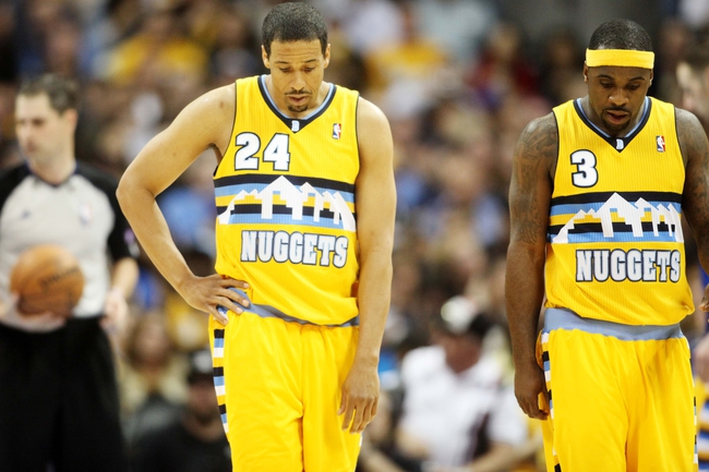 Apr 20, 2013; Denver, CO, USA; Denver Nuggets guard Andre Miller (24) and guard Ty Lawson (3)  during the second half of game one of the first round of the 2013 NBA Playoffs against the Golden State Warriors at the Pepsi Center. The Nuggets won97-95.  Mandatory Credit: Chris Humphreys-USA TODAY Sports