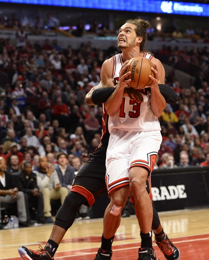 May 13, 2013; Chicago, IL, USA;  Chicago Bulls center Joakim Noah (13) is fouled by Miami Heat shooting guard Dwyane Wade (3) during the second half at the United Center. Miami defeats Chicago 88-65. Mandatory Credit: Mike DiNovo-USA TODAY Sports