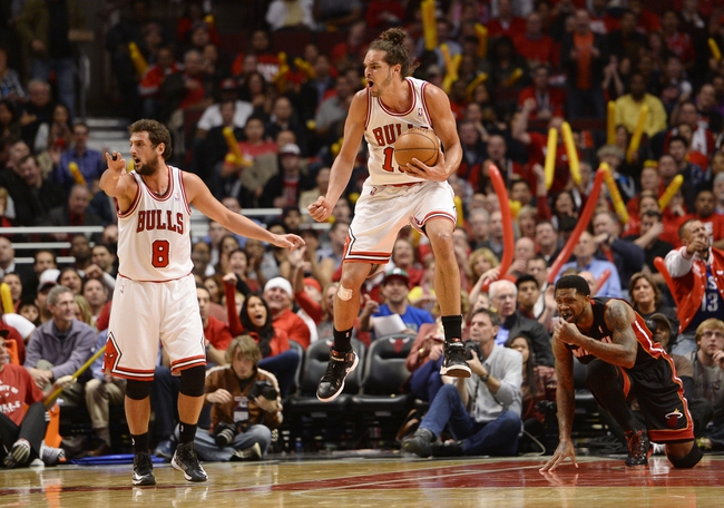 May 13, 2013; Chicago, IL, USA; Chicago Bulls center Joakim Noah (13) reacts to a call against the Miami Heat during the second half at the United Center. Miami defeats Chicago 88-65. Mandatory Credit: Mike DiNovo-USA TODAY Sports