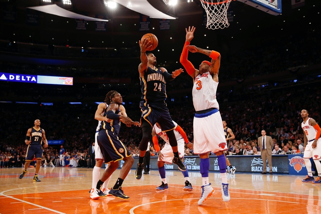 May 16, 2013; New York, NY, USA;  Indiana Pacers small forward Paul George (24) shoots over New York Knicks power forward Kenyon Martin (3) during the third quarter of Game 5 in the Eastern Conference semifinals at Madison Square Garden. Knicks won 85-75.  Mandatory Credit: Anthony Gruppuso-USA TODAY Sports