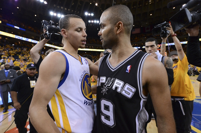 May 16, 2013; Oakland, CA, USA; Golden State Warriors point guard Stephen Curry (30) congratulates San Antonio Spurs point guard Tony Parker (9) after game six of the second round of the 2013 NBA Playoffs at Oracle Arena. The Spurs defeated the Warriors 94-82.  Mandatory Credit: Kyle Terada-USA TODAY Sports