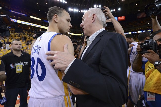 May 16, 2013; Oakland, CA, USA; Golden State Warriors point guard Stephen Curry (30) congratulates San Antonio Spurs head coach Gregg Popovich (right) after game six of the second round of the 2013 NBA Playoffs at Oracle Arena. The Spurs defeated the Warriors 94-82.  Mandatory Credit: Kyle Terada-USA TODAY Sports