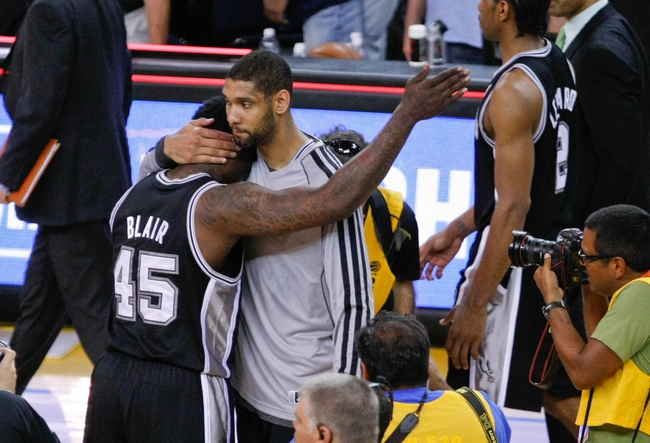 May 16, 2013; Oakland, CA, USA; San Antonio Spurs power forward Tim Duncan (21) hugs center DeJuan Blair (45) after the win against the Golden State Warriors of game six of the second round of the 2013 NBA Playoffs at Oracle Arena.  The San Antonio Spurs defeated the Golden State Warriors 94-82 to win the series. Mandatory Credit: Kelley L Cox-USA TODAY Sports